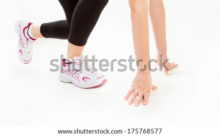 Fitness. Feet of jogging person on white background