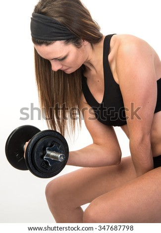 Fitness female using weights for training results - stock photo