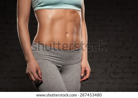Fitness female woman with muscular body, do her workout, abs, abdominals - stock photo
