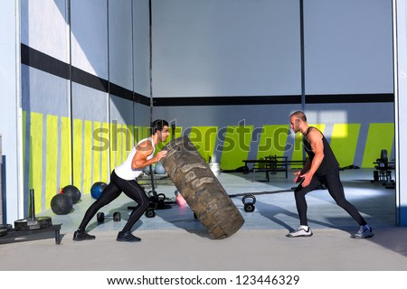 Fitness flip tires men flipping each other the wheel workout