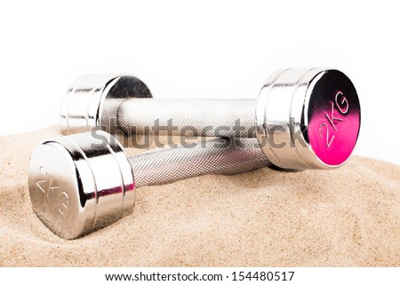fitness gear on beach sand