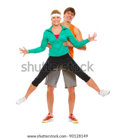 Fitness girl and man in sportswear having fun isolated on white - stock photo