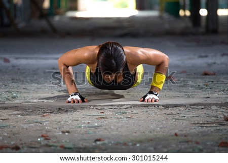 fitness girl doing pushups - stock photo