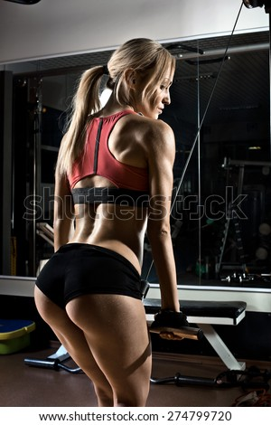 fitness girl,  execute exercise with gym apparatus, on triceps - stock photo
