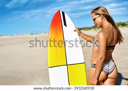 Fitness Girl. Extreme Summer Water Sports. Surfing. Healthy Fit Woman With Perfect Sexy Body And Butt, Buttocks In Bikini Posing With Surfboard On Ocean Beach. Vacations, Lifestyle, Beauty, Health