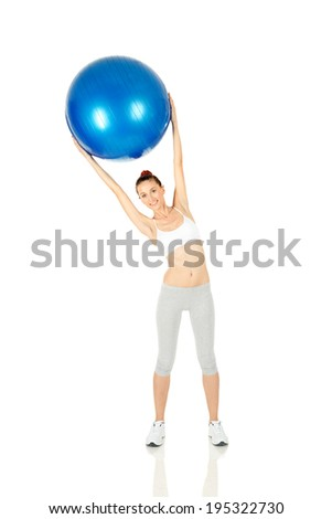 Fitness girl holding exercising ball