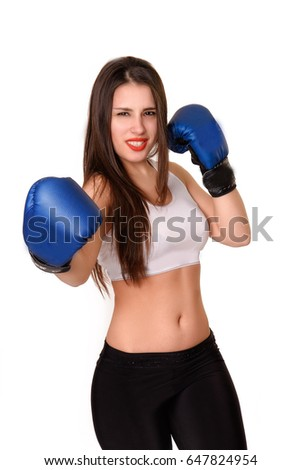 Fitness girl in boxing gloves fighting on white background