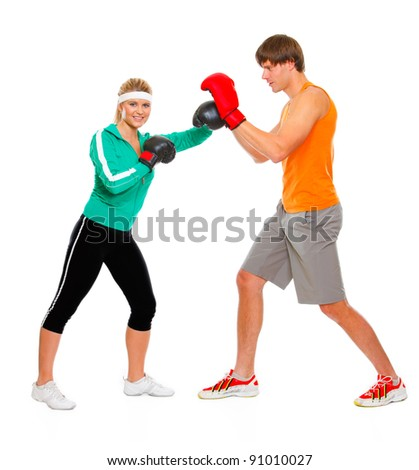 Fitness girl training boxing with help of personal trainer isolated on white - stock photo