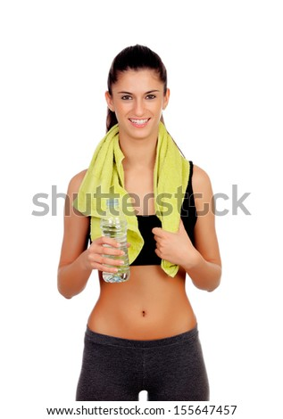 Fitness girl with a towel drinking water isolated on a white background