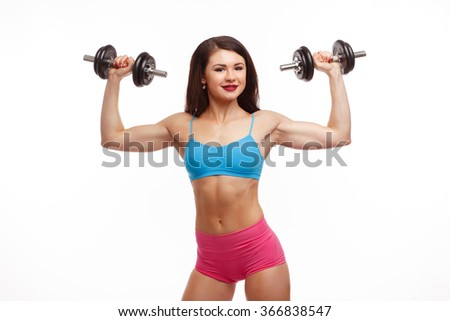 Fitness girl with dumbbells isolated on white background