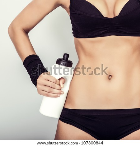 Fitness girl with water close up - stock photo