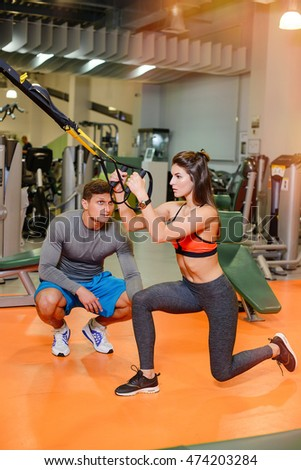 fitness girl with  working with a trainer . The concept of health, sports
