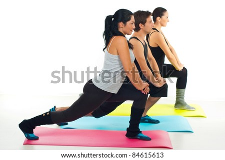 Fitness group of people doing exercises on colorful mats over white background - stock photo