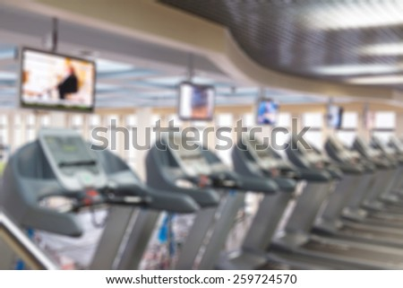 Fitness gym centre abstract blur background with bokeh - stock photo
