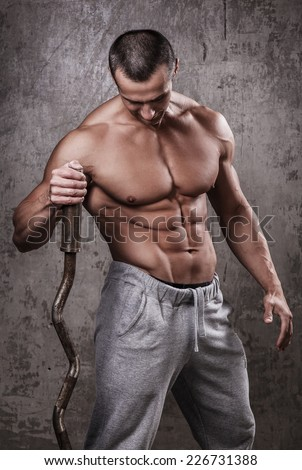 Fitness. Handsome man during workout - stock photo