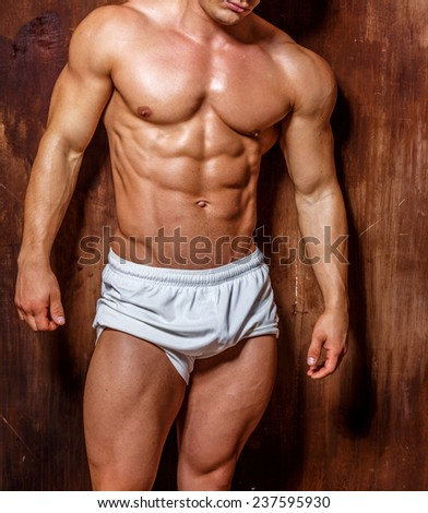 Fitness. Handsome man with perfect body.studio shot . - stock photo