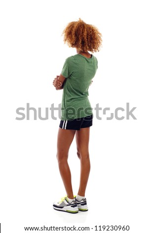 Fitness hispanic / black woman from the back, looking at something over white background