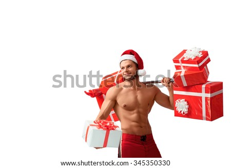 Fitness holidays. Ripped fitness man wearing Santa Claus hat giving away a present posing with a barbell on his shoulder isolated on white - stock photo