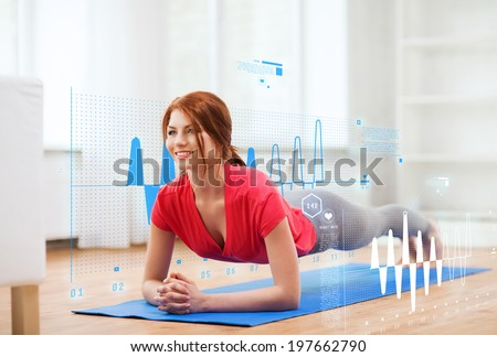 fitness, home and diet concept - smiling redhead teenage girl doing plank at home - stock photo