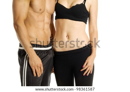 Fitness image of a man and woman's torso isolated on a white background