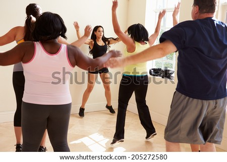 Fitness Instructor In Exercise Class For Overweight People - stock photo