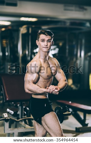Fitness male at the gym all the muscles straining and screaming with the effort - stock photo
