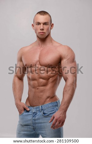 Fitness male model in studio - stock photo