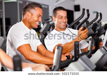 fitness man and personal trainer in gym - stock photo