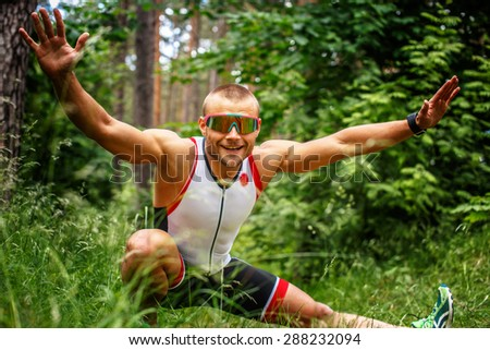 Fitness man doing exercises on nature.