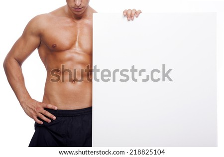 Fitness man holding a white banner - stock photo