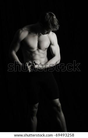 Fitness man, low key - stock photo