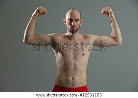 Fitness man with his strong arms