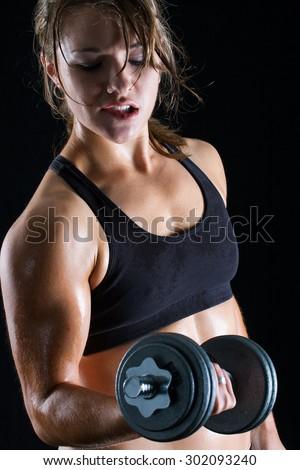 Fitness model lifting dumbbell - stock photo