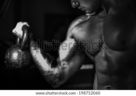 Fitness Model lifting kettle bell  - stock photo