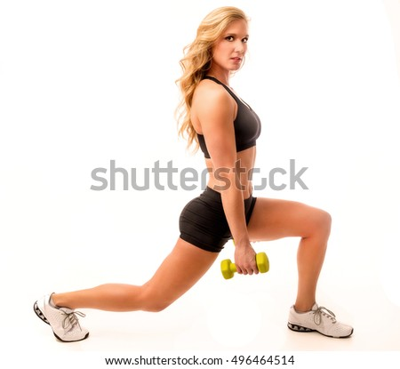 Fitness model lunge pose in workout outfit