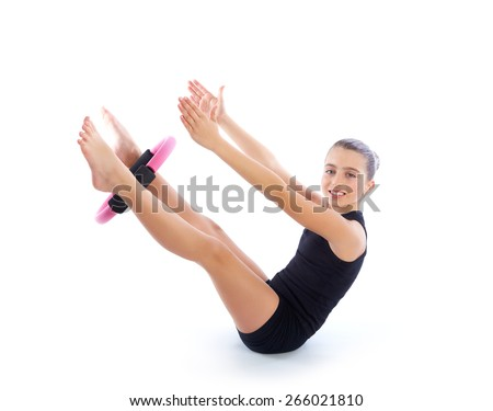 Fitness pilates yoga ring kid girl exercise workout on white background - stock photo