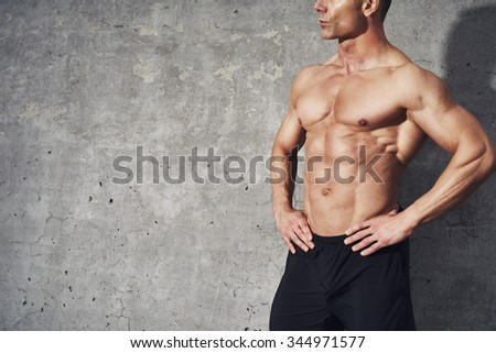 Fitness portrait half body six pack no shirt, fitness concept, room for copyspace, fit and healthy muscular male body with abdominal muscles