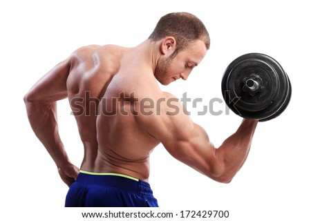 Fitness. Powerful guy with a dumbbell - stock photo