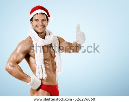 fitness sexy Santa Claus in  white scarf, smile, on blue background