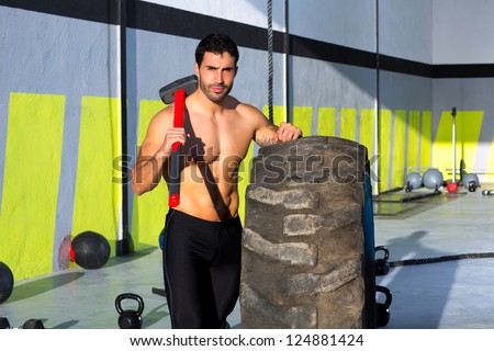 Fitness sledge hammer man workout at gym relaxed after exercise - stock photo