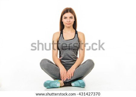 Fitness smiling woman in the form in the lotus position. Healthy lifestyle. Mock up. Human