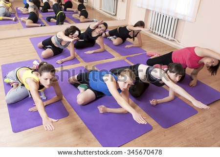 Fitness, Sport and Healthy Life Concepts. Group of Seven Young Caucasian Females Having Fitness Class in Sport Club and Stretching. Horizontal Composition - stock photo
