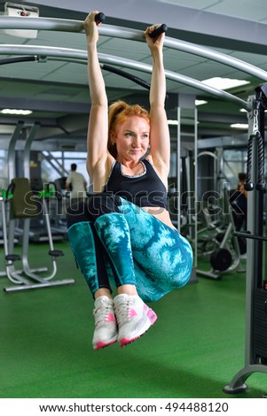 Fitness, sport, exercising lifestyle - Fit woman doing exercises on horizontal bar in gym