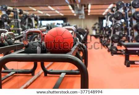 fitness, sport, exercising, weightlifting and bodybuilding concept - close up of kettlebell and medicine ball with sports equipment in gym - stock photo