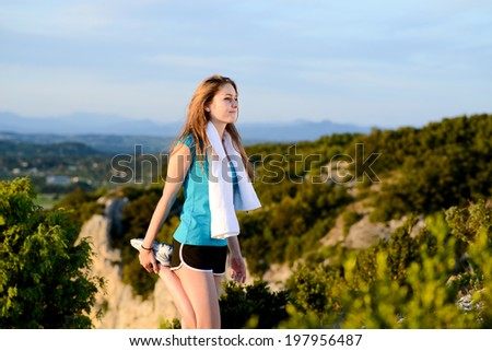 fitness sport healthy and cheerful young woman running outdoor in the countryside