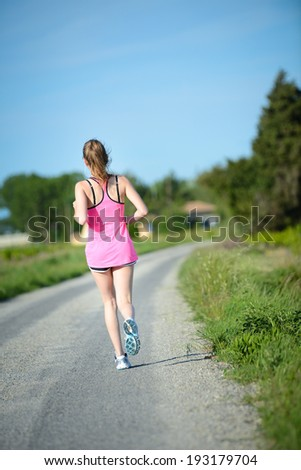 fitness sport healthy cheerful young woman running outdoor in the countryside