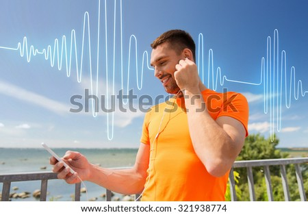 fitness, sport, people, technology and healthy lifestyle concept - smiling young man with smartphone and earphones listening to music at summer seaside over sound wave or signal diagram - stock photo