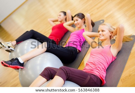 fitness, sport, training, gym and lifestyle concept - group of smiling people working out in pilates class - stock photo