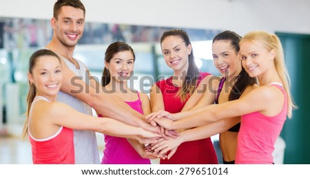 fitness, sport, training, gym, success and lifestyle concept - group of happy people in the gym celebrating victory - stock photo