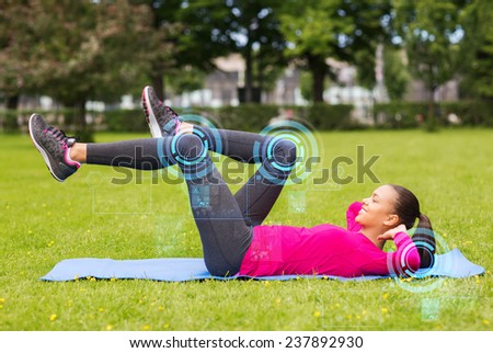 fitness, sport, training, park and lifestyle concept - smiling woman doing exercises on mat outdoors - stock photo